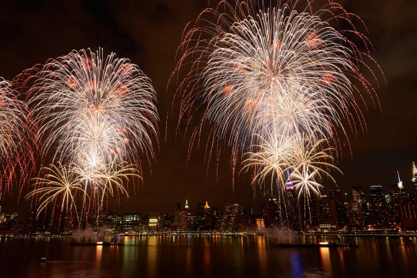 The Macy's 4th of July Fireworks show illuminating the Manhattan Skyline.
